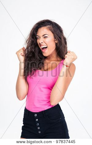 Portrait of a happy female teenager celebrating her success isolated on a white background