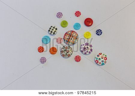 Different Of Bottons Are On White Background