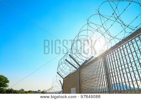 Metal Fence With Barbwire