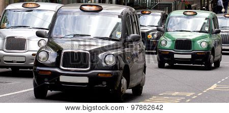 Five London Taxi Cabs