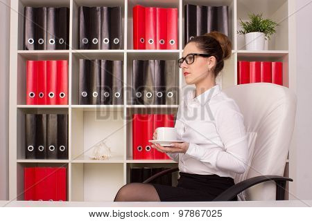 Business woman sitting with cup of coffee