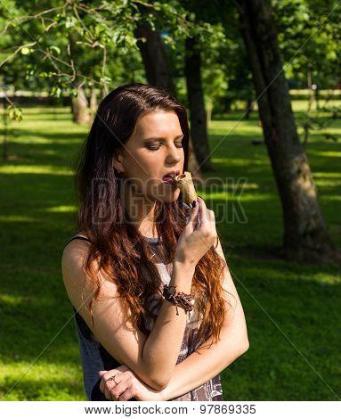 Sexy beautiful woman greedily eat ice-cream