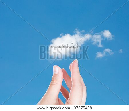 Hand with cloud of travel  in blue sky   (Japan,France,Italy,New York,India,egypt)