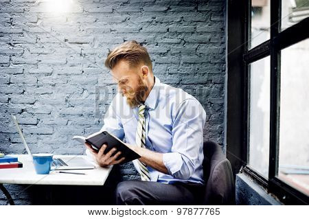 Business Man Reading Notes Book Concept
