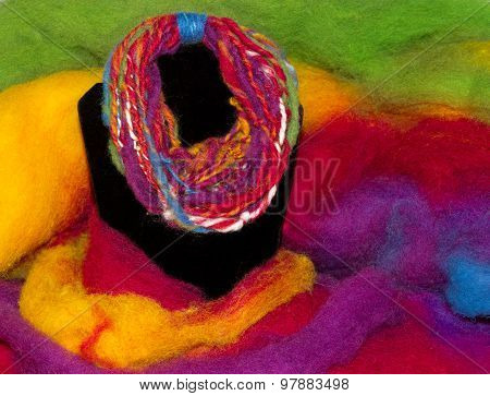 Handycraft necklace homespun with a handspindle on a colorful sheep fleece poster