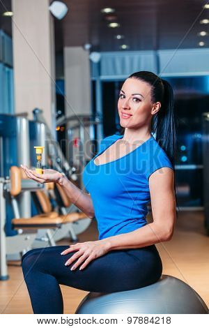 fitness, sports, training, lifestyle - smiling woman with implementation of exercises on the ball in