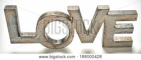 cracked wooden word love on white background top angle view