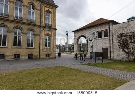 STUTTGART GERMANY - MARCH 01 2017: Courtyard of the New Palace in the background Schlossplatz (Palace Square) and Jubilaeumssaeule (Jubilee column).