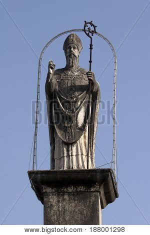 Statue of St John of Trogir above the north entrance in the city Trogir in Croatia