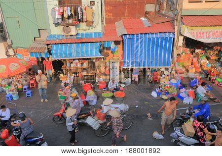 HO CHI MINH CITY VIETNAM - NOVEMBER 28, 2016: Unidentified people visit street market in downtown Ho Chi Minh city.