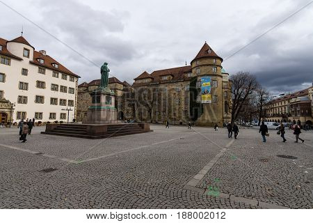 STUTTGART GERMANY - MARCH 01 2017: Schillerplatz - square in the old city named in honor of the German poet Friedrich Schiller. In the background Alte Kanzlei (The Old Chancellery) and the Old Castle.