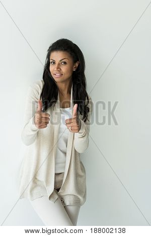 Attractive African American Woman Showing Thumbs Up Isolated On White