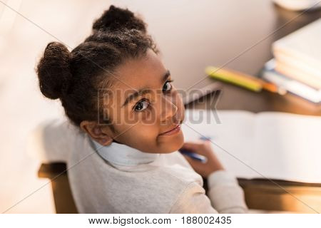 Close-up Portrait Of Cute Little African American Girl Drawing With Felt Tip Pens, Doing Homework Co