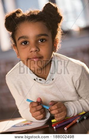 Close-up Portrait Of Cute Little Girl Drawing With Colorful  Felt Tip Pens And Looking At Camera, Do