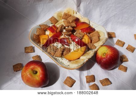appetizing salad from fresh dairy products, cereals and colorful juicy ripe fruits