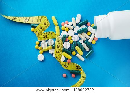 Measuring Tape And Pills For Dieting Concept. Electrocardiogram With Pills And Tablets Above, Ekg Me