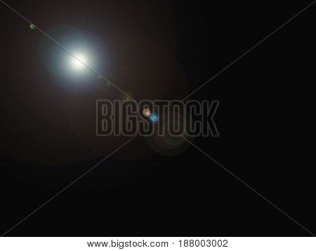 Abstract digital lens flare in black background