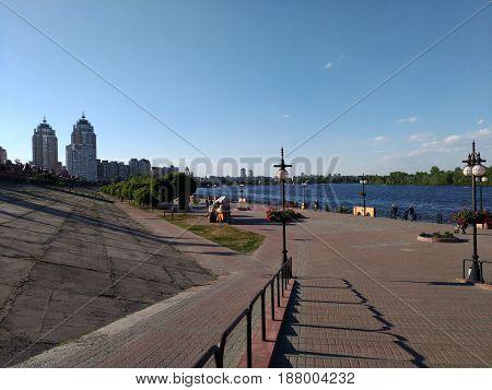Obolonskaya embankment in Kiev, Ukraine. Concrete embankment near the Dnieper River. Landscape design
