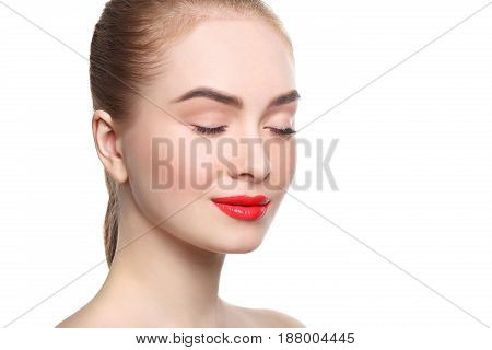 Skin makeup. Beautiful girl with red lips closed eyes portrait isolated on white, crop