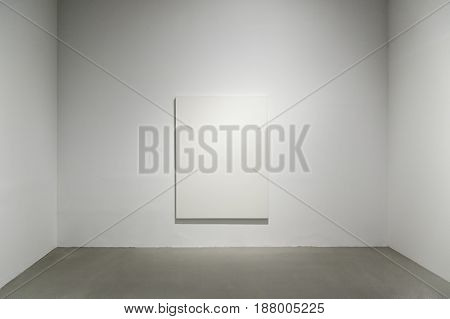 Blank canvas on a wall detail of an unpainted painting art and architecture...