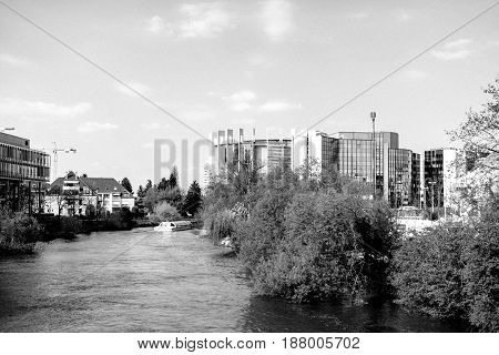 STRASBOURG FRANCE - APR 3 2017: European Parliament building Council of Europe building Arte Television building and batorama boat on a calm warm spring morning - view from above Ill river in Strasbourg