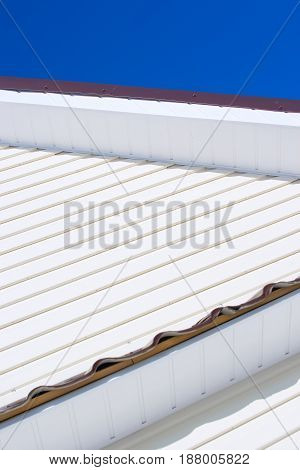 Siding against the sky building construction Roof