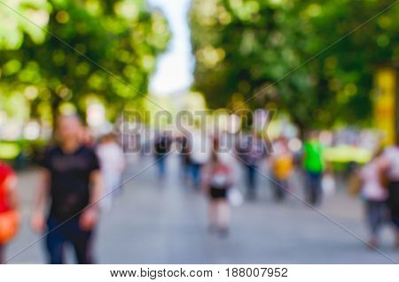 People walking on city rides in the summer. Blurred.