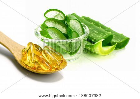 Vitamin E Capsules And Sliced Aloe Vera.