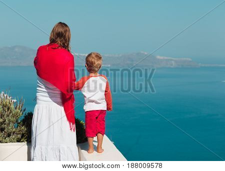 mother and little son travel in Santorini, Greece, family travel