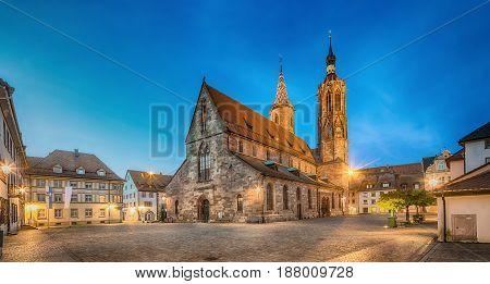 Catolic cathedral on Munsterplatz square in Villingen-Schwenningen at dusk Baden-Wurttemberg Germany