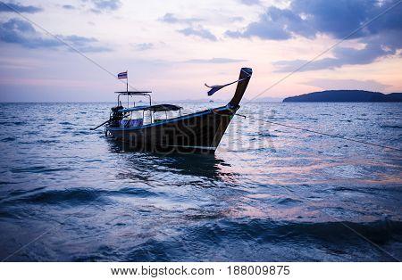 Longtail boat on sunrise. Andaman Sea, Thailand