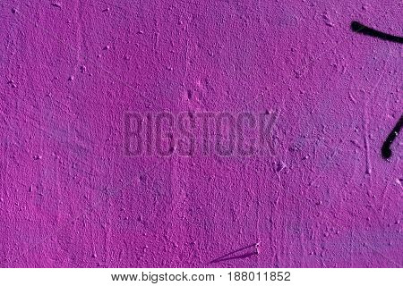 Abstract grunge texture background with purple color. Aged paint on old rough dirty metal surface close-up, with space for copy