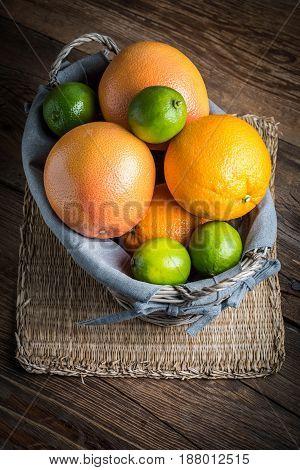 Fresh Juicy Citrus Fruits In A Basket.