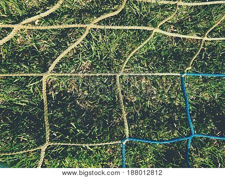 soccer ball green grass field soccer line. Hang bended blue yellow soccer nets soccer football net.