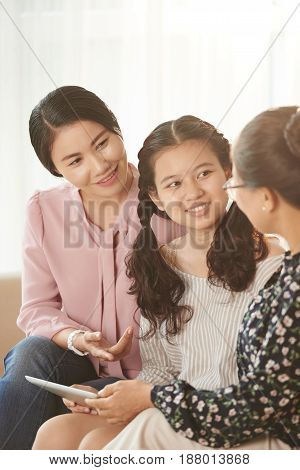 Female generation of Vietnamese family chatting at home