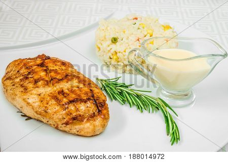 Delicious Meat Cutlet, Herbs, Rice With Corn And Sauce, On A White Plate. Horizontal Frame