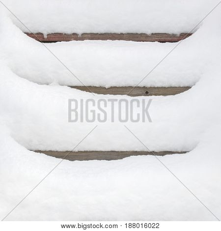 Wooden stairway covered with fresh snow, winter time