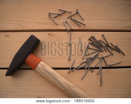 Hammer and nails on the wooden table, DIY tools