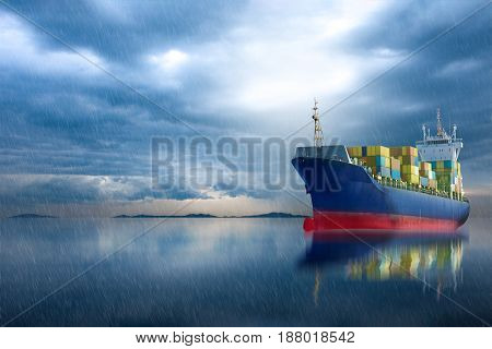 Container ship in ocean on storm sky .