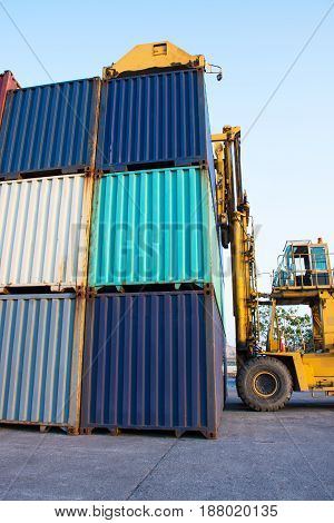 container with forklift loading goods to truck import export international cargo.