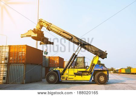 forklift loading container shipping to customer import export.