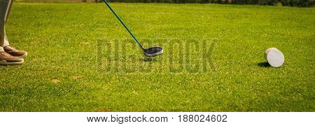 Golfer lining up his tee shot in prince edeward island