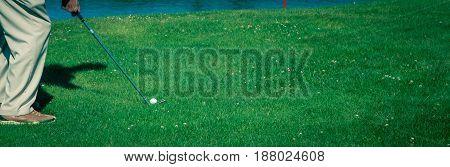 Golfer swinging an iron in Prince Edward Island