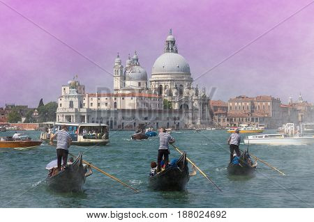 VENICE, ITALY - MAY 23, 2017: Mystique view of Venice at romantic sunset. Three gondolas on canal grande and Santa Maria della Salute church, Veneto, Italy