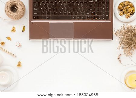 Woman's Workspace With Laptop, Candles, Flowers, On White Background. Flat Lay.