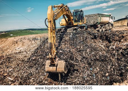 Industry Details - Excavator Working On Urban Trash Dumping Grounds