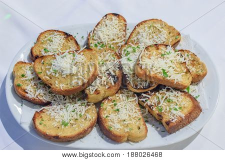 Fried Bread In A Barbecue And Sprinkled With Parmesan Cheese