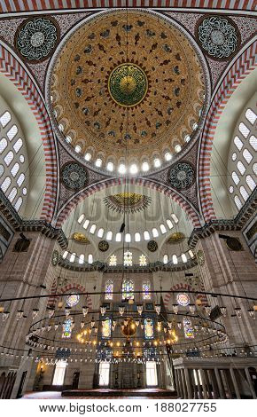 Istanbul, Turkey - April 19, 2017: Interior low angle shot of Suleymaniye Mosque an Ottoman imperial mosque built in 1557 located on the Third Hill of Istanbul Turkey and the second largest mosque in the city