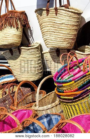 Shopping for colorful straw bags and wicker woven baskets