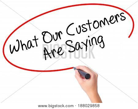 Women Hand Writing What Our Customers Are Saying With Black Marker On Visual Screen